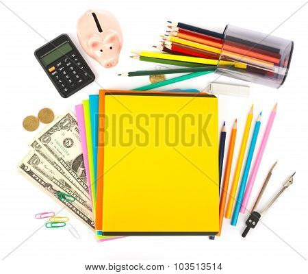 Copybooks with piggy bank and office stuff