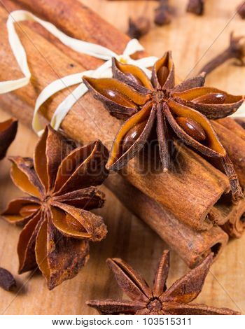 Star Anise, Cinnamon Sticks And Cloves On Wooden Table, Seasoning For Cooking