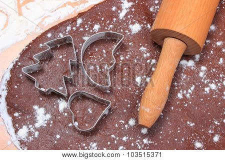 Cookie Cutters And Rolling Pin On Dough For Cookies And Gingerbread