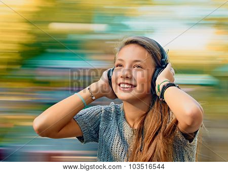 teen girl with music headphones