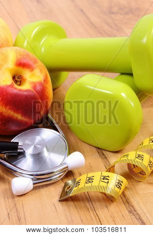 Medical Stethoscope, Fruits And Dumbbells For Using In Fitness