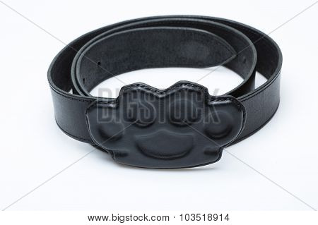 black belt with a buckle in the form of brass knuckles