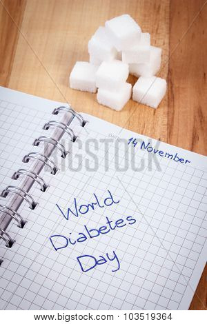 Inscription World Diabetes Day In Notebook And Sugar Cubes, Symbol Of Diabetic