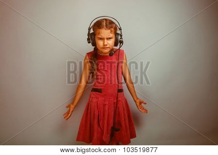 dissatisfied angry teen girl with headphones listening to music