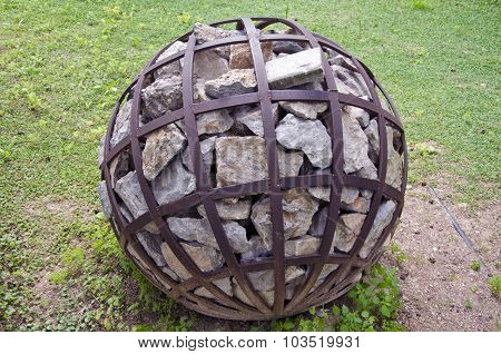 Spherical Decorative Object With Stone In Park, Greece