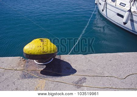 Ship Tied To A Bollard