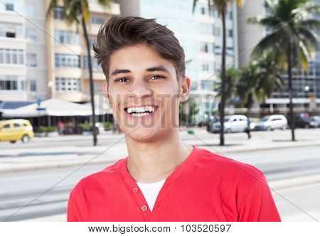 Laughing Hispanic Guy In The City Looking At Camera