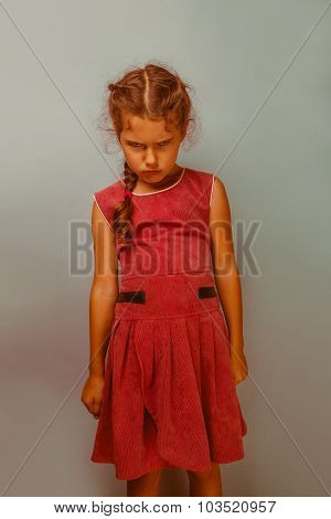 Girl European appearance decade  angry frowns blue background re