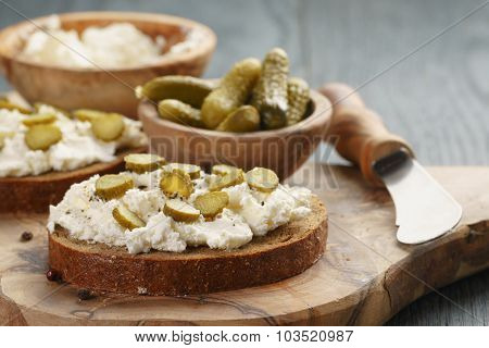 sandwiches with rye bread, cream cheese and marinated cucumbers