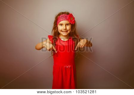 Girl European appearance haired child of seven in red bright dre