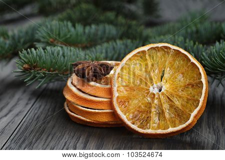 orange and anise with fir twig