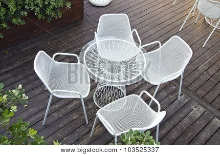 Glass Table With Four Chairs In Outdoors Yard