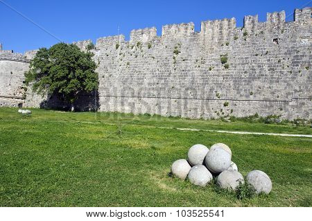 Stone Wall,  Tree And Pile Round Stone Objects In Greece