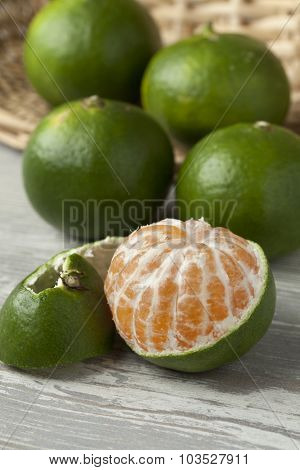 Green and peeled satsuma fruit