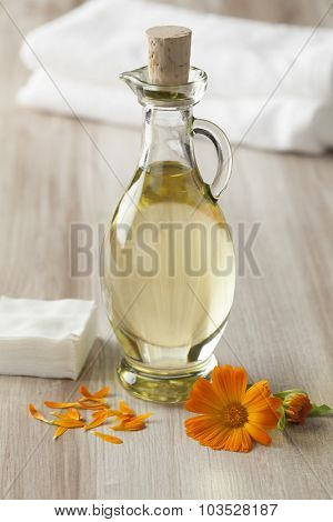 Bottle with Pot marigold oil for cosmetic use
