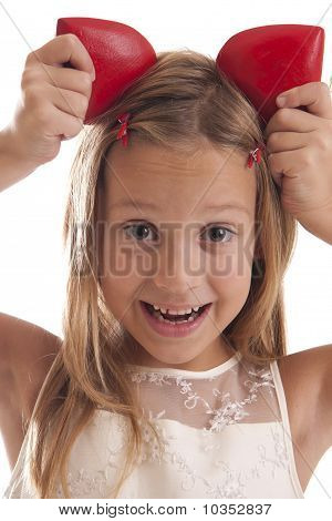 child hold red hearts on her head on white background