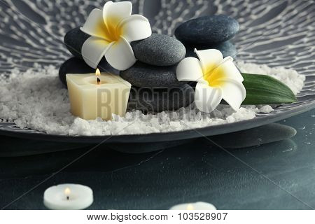 Still life with spa stones in grey tray, closeup