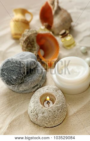 Stack of spa stones on sand background