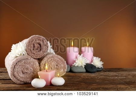 Beautiful spa composition with chrysanthemums on brown background