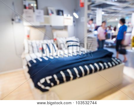 Blurred Bedroom With People Shopping