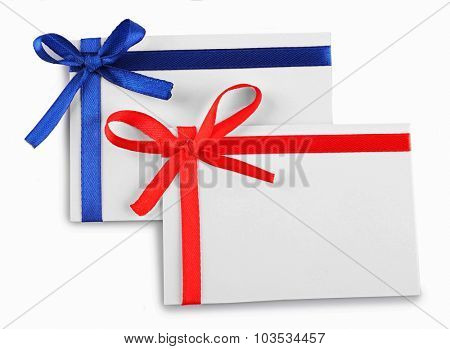 Cards decorated with bows isolated on white