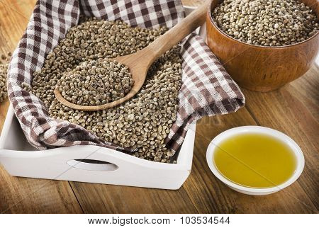 Hemp Seeds And Oil On A Wooden Background.