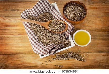Hemp Seeds And Hemp Oil On A Wooden Background.