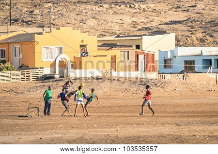 Luderitz, Namibia - 24 November 2014: Local Young People Playing Football In The Playground