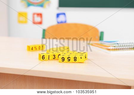 School desk with plastic cubes in classroom