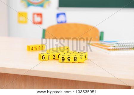 School desk with plastic cubes in classroom