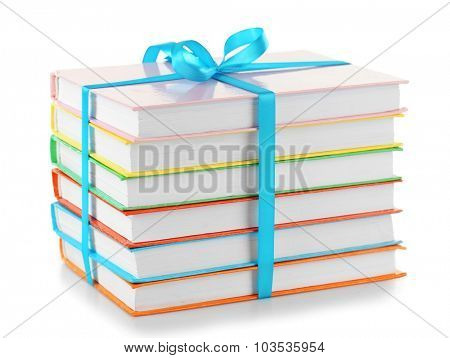 Stack of books with ribbon isolated on white