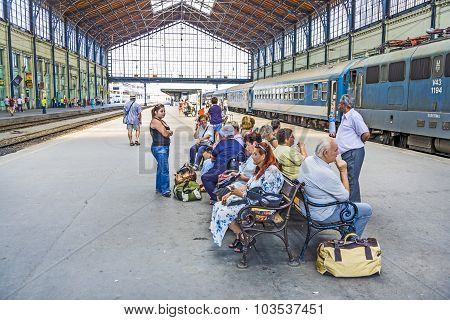 Unidentified People Wait At  The Train Station In Budapest