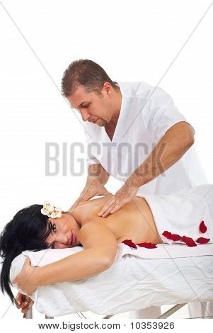 Masseur Giving Shiatsu Massage To Woman
