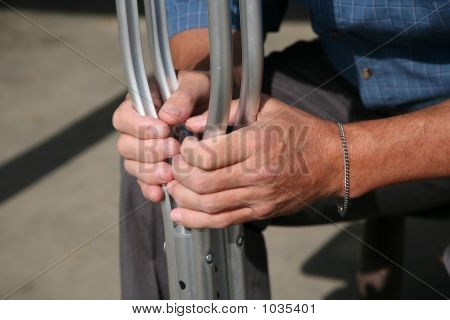 Hands Holding Crutches