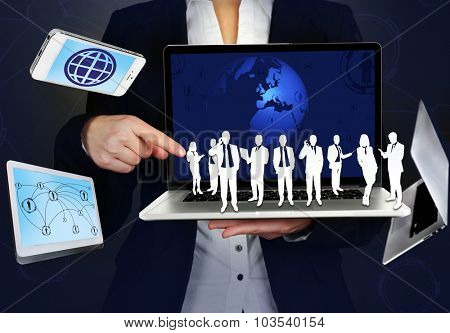 Businesswoman holding social object