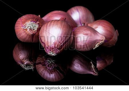 Group of shallots on black background