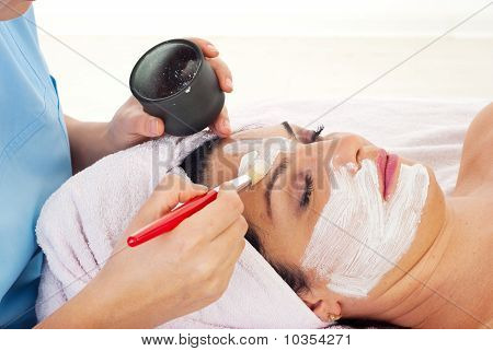 Close Up Of Applying Woman's Facial Mask