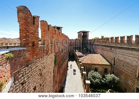 VERONA, ITALY - SEPTEMBER 2014 : People walking inside the Castle Fortress (Castelvecchio) in Verona, northern Italy on September 14, 2014. Castelvecchio was built during Middle Ages.