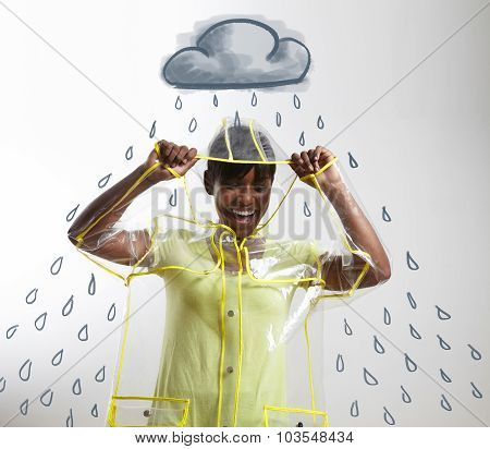Black Woman In Transparent Raincoat With Drawn Rain And Cloud