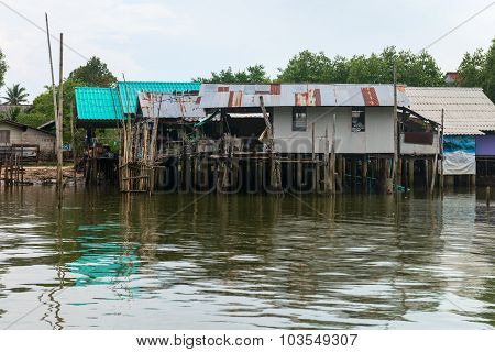 Traditional Thai Houses On Stilts Over The Water In Krabi, Thailand.