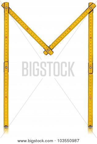 Font M - Old Yellow Meter Ruler