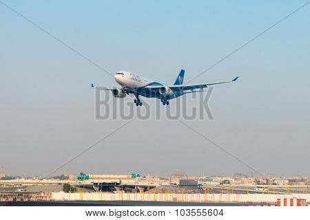 Passenger Liner From Oman Air, On Final Approach For Landing At Dubai International Airport.
