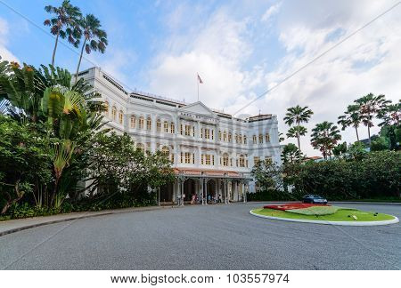 Grand Facade Of The Luxurious Raffles Hotel In Downtown Singapore, With Its Beautiful Gardens.