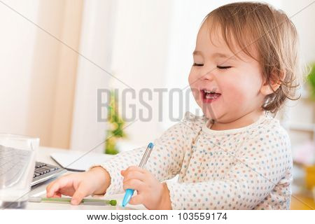 Happy Toddler Girl With A Huge Smile Playing