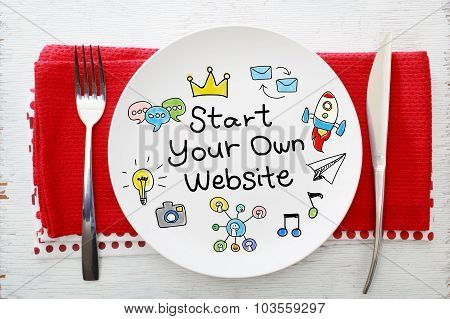 Start Your Own Business Concept On White Plate