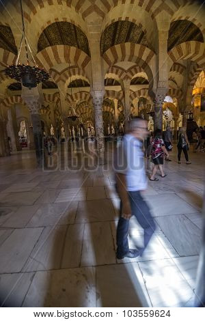 Interior Of Mezquita-catedral,  Interior Of Mezquita-catedral, Tourists Walking Inside The Mosque, U
