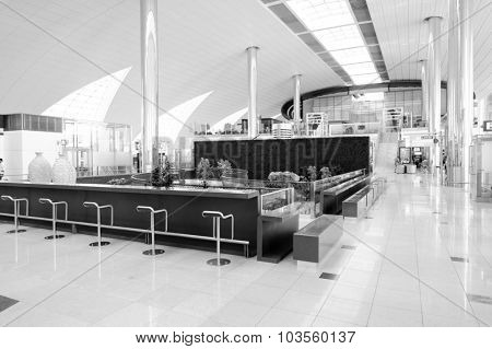 DUBAI, UAE - MARCH 10, 2015: DXB airport interior. Dubai International Airport is an international airport serving Dubai. It is a major airline hub in the Middle East, and is the main airport of Dubai