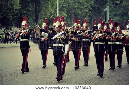 LONDON, UK - SEP 27: Change of Guard parade on September 27, 2013 in London, UK. The ceremony is one of the top attractions in London and UK military traditions.