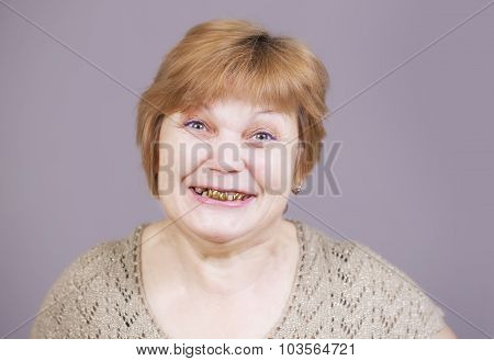Very emotional gold teeth woman on a gray background