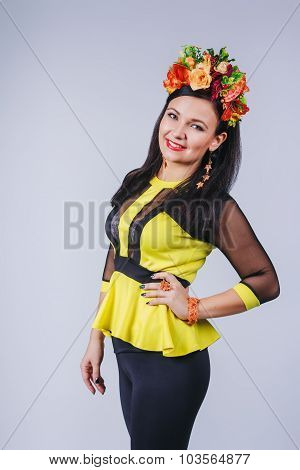 Attractive Woman With Coronet Of Flowers In Autumn Style